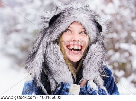Wintertime. Smiling Girl In Snow Park. Beautiful Young Woman In Winter. Beautiful Female In Warm Coa