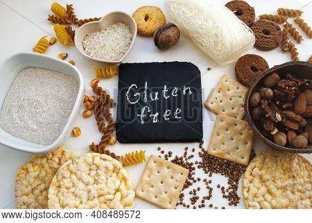 Gluten Free (sans Gluten) Sign Handwritten On A Chalk Board Surrounded By Ingrediients Close Up.