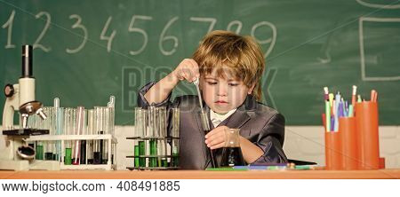 Science Experiments With Microscope In Lab. Biology. Little Boy Is Making Science Experiments. Littl