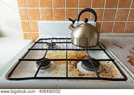 Very Dirty Gas Stove And Kettle Stained While Cooking, A Stove Covered In Grease. Mess In Kitchen Ro