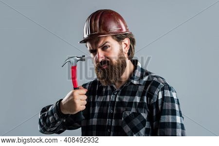 Handsome Bearded Guy With Beard And Moustache Hold Hammer, Building