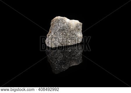Natural Mineral Rock Specimen - Raw Arsenopyrite Stone On Black Glass Background From Kachkarskoe, U