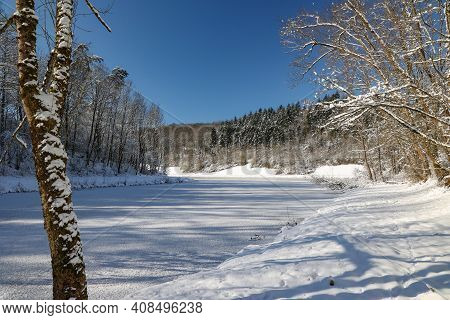 A Frozen Lake On A Clear Winter Day.