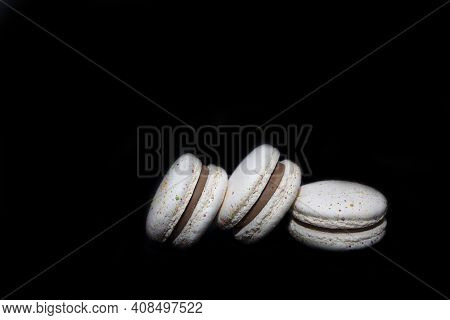 Macaroon Cakes Isolated On A Black Background. Macaroons Sweet Dessert Concept