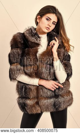 Fur Store Model Posing In Soft Fluffy Warm Coat. Pretty Fashionista. Fur Fashion Concept. Woman Make