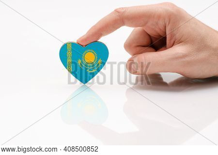 Love And Respect Kazakhstan. A Man's Hand Holds A Heart In The Shape Of The Kazakhstan Flag On A Whi