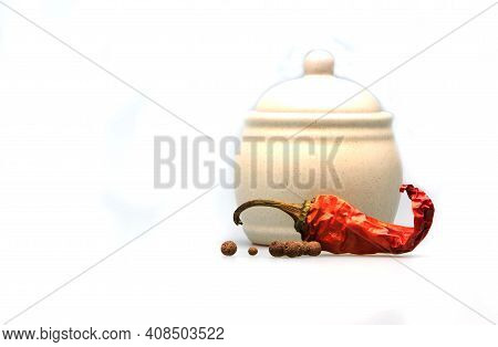 White Porcelain Spice Bowl With Allspice And Dry Red Hot Pepper Pod Isolated On White Background. He