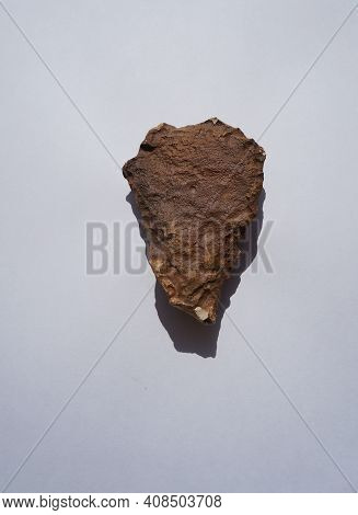 Ancient Scraper Made Of Flint From Prehistorical Time On White Background