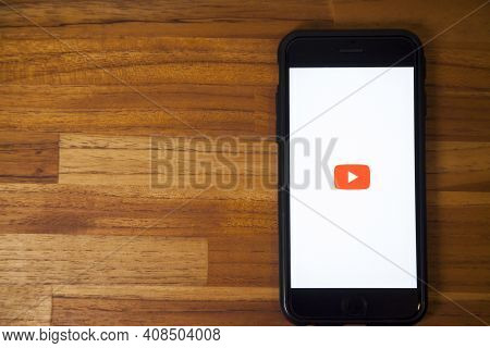 Sao Paulo, Brazil. Feb 06, 2021: Smartphone On The Table With Open Youtube Application, An Online Vi