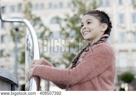 Staying Beautiful. Small Kid With Fashion Look. Little Kid With Brunette Hair Smiling In Casual Styl
