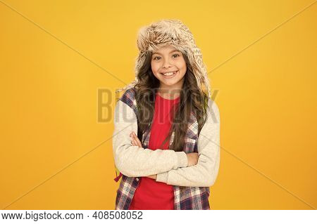 Keep Little Head Warm And Fashionable. Happy Child With Fashionable Winter Look On Yellow Background