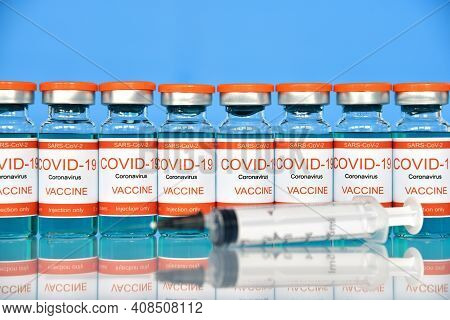 Covid-19 Vaccine And Syringe Injection. Healthcare And Corona Virus Vaccination Concept.