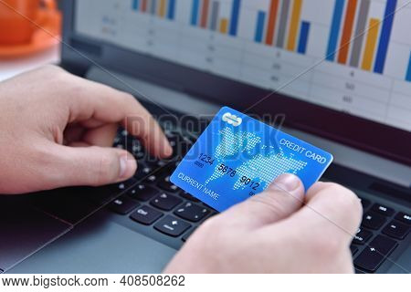 Hands Using Laptop Computer And Credit Card. Online Payment And  Shopping Concept. Close Up