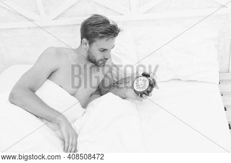Man Sleeping Bed White Bedclothes And Red Alarm Clock, Time To Wake Up Concept.