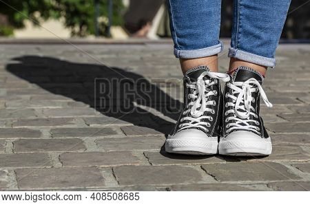 Chartres, France - Spetember 2, 2019: Image Of  The Lower Part Of Teenager's Legs In Jeans And All S