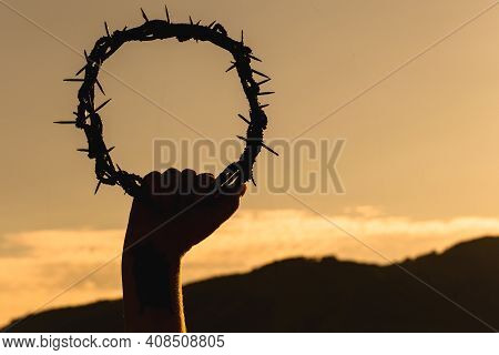 Hand Holding Crown Of Christ On Blue Sky With Clouds, Hand Of Christ, Easter Concept Ous Exta Passio