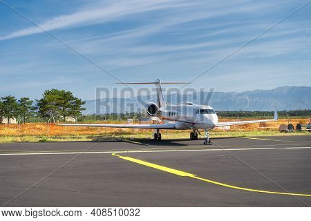 Small Airplane Parked On Airport. Use Of Private Jets To Avoid Coronavirus Risk And Restrictions. Di