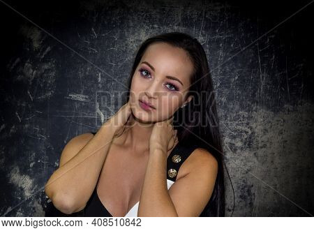 Young, Beautiful, Fashionable Girl With Beautiful Make-up Close-up On A Dark Background