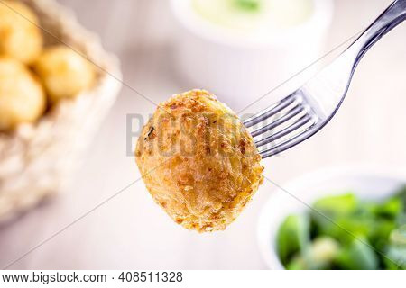 Fried Rice Ball Served On The Fork, Spot Focus. Typical Brazilian Fried Food