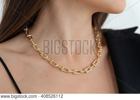 Beautiful Model Brunette In Modern Gold Metal Necklace Chain