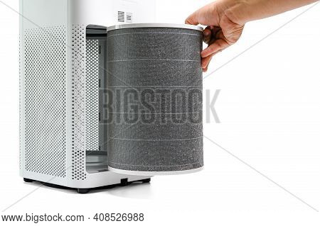 Man Hold A Old Filter Of  The Air Purifier Check With Change Filter In Side Air Purifier For Dust Re