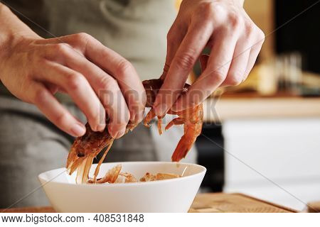 Process Of Hands Peel Shrimps Shell. Woman Cleaning Shrimps For Cooking