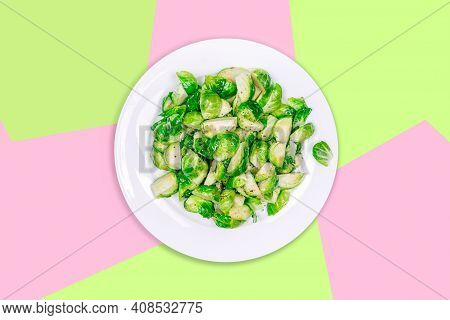 Plate With Lightly Fried Brussels Sprouts On The Creative Futuristic Neon Green And Pink Color Drop