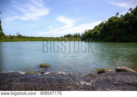 Still Lake View With Green Forest And Blue Sky. Peaceful Summer Landscape For Ecological Banner Temp