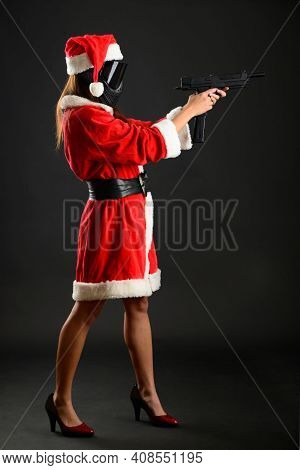 Sexy Young Girl In Santa Claus Costume Posing Like Playing Paintball