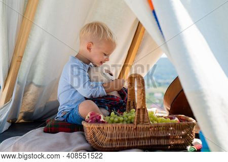 Kids Camping. Happy Kid In Tent. Boy Playing In Tent. Having Fun Outdoors. Campground