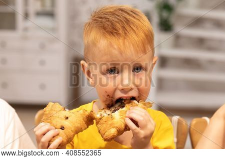 Young Boy With Chocolate On His Face