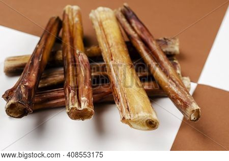 Useful Dried Chewy Treats For Pets In Close-up. Dried Bovine Penis, Bully Sticks, Beef Pizzle For Do