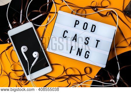 Podcasting Lettering And Vinyl Record Audio Cassette Tape Album Headphones And Mobile Phone. Milleni
