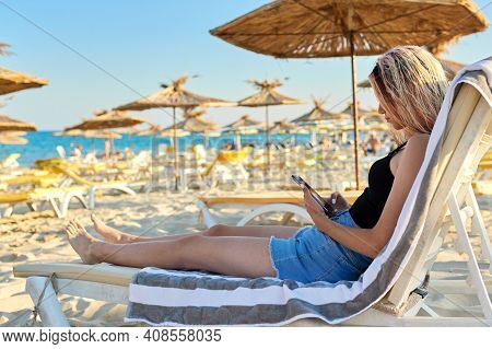 Vacation At Sea, Weekend On Beach, Beautiful Tanned Teenager Girl In T-shirt Shorts With Wet Hair Lo