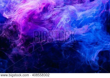 Paint In Water. Colorful Art Background. Fluorescent Smoke Texture. Universe Energy. Glowing Bright