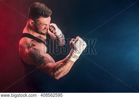 Sportsman Muay Thai Boxer Fighting On Black Background With Smoke. Sport Concept.