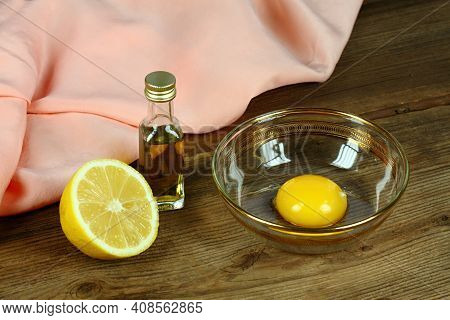 Homemade Facial Mask Against Wrinkles. Ingredients Yolk, Olive Oil And A Few Drops Of Lemon.