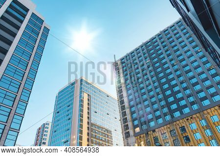 Several Multi Storey Buildings With A Glass Facade And Under Construction With A Facade Section, Wit