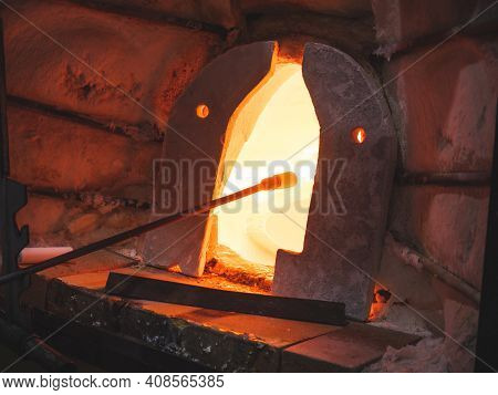 Glass Blowing Furnace And Traditional Tools At A Glass Makers Workshop. Artist Makes Through  Tradit