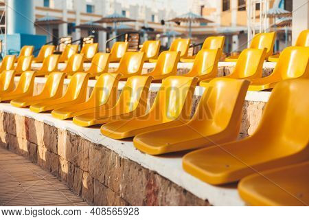Stone Steps With Yellow Plastic Seats. Symbol Of Closed Borders, Empty Hotels Without Tourists. Coro