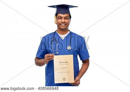 medicine, education and graduation and concept - smiling indian doctor or medical graduate student in blue uniform and mortarboard with stethoscope and diploma showing thumbs up over white background