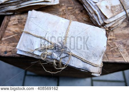 Set Of Dirty Dusty Old Antique Letters, Tied With Cord And Loop. Grunge Mail Envelope Or Letter With