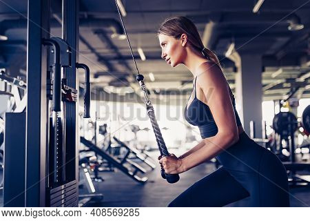 Fit Woman Workout Triceps Lifting Weights In Gym. Athletic Sexy Woman Doing Exercise Using Machine I