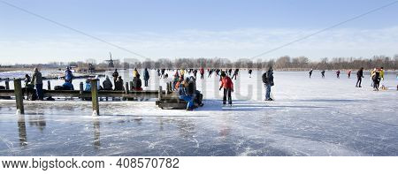 Zevenhuizen, Netherlands - February 13, 2021: Panorama Of A Dutch Winter Landscape With Ice Skaters