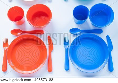 Top View Of A Plastic Crockery Set On A White Background