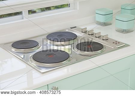 Modern Clean Kitchen With Electric Cooker Stove At A Home.