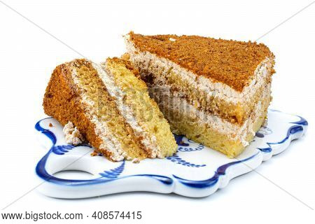 Cake, A Slice Of Delicious Honey Cake. A Piece Of Cake On A Porcelain Platter. Isolated On A White B