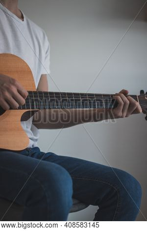 Casual Day Of A Young Singer Who Trains Various Guitar Holdings And Chords To Improve His Skills. Pl