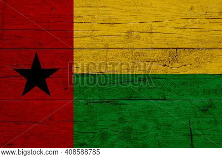 Flag Of Guinea-bissau. Wooden Texture Of The Flag Of Guinea-bissau.