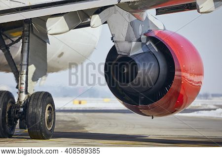 Hot Air Behind Jet Engine Of Plane At Airport. Commercial Airplane Taxiing To Runway Before Take Off
